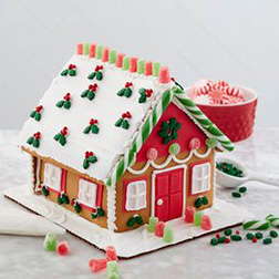Mistletoe Draped Gingerbread House