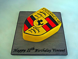 Raised Yellow Porsche Logo Cake