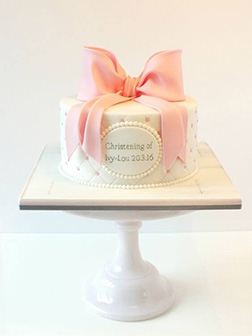 Pink Flowing Bow Christening Cake